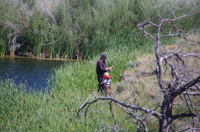 Bob teaching Kyle to fish
